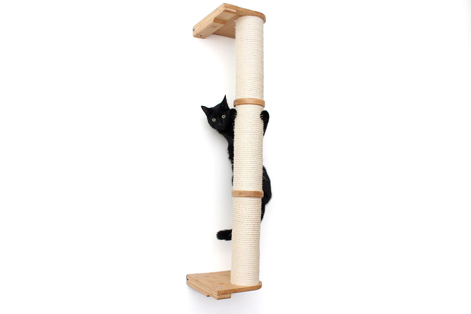 This photo displays a cat climbing the three tier Sisal Pole in Natural, a light brown stain.