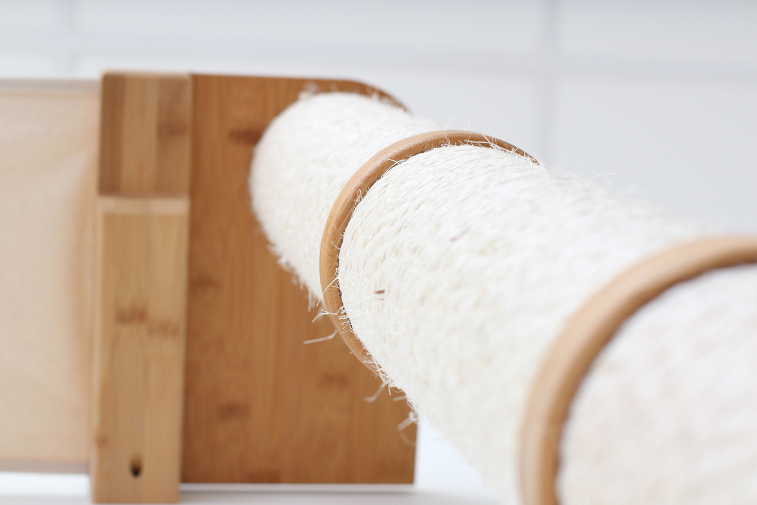 close up of wall mounted scratching post and connectors