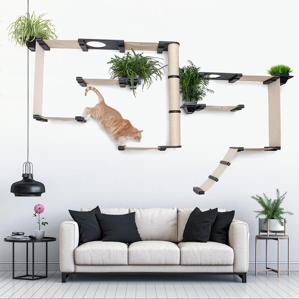 This photo displays a cat jumping on the Gardens Complex in a living room setting. This image shows the Gardens Complex in Onyx, a black stain, and has Natural fabric, a light tan color.