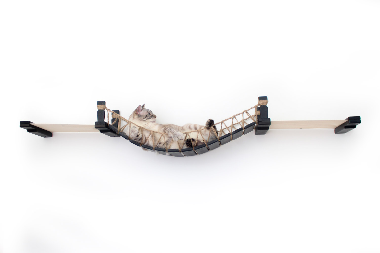 This photo displays our cat relaxing on the Bridge Lounge. This image shows the Bridge Lounge in Onyx, a black stain, and has Natural fabric, a light tan color.
