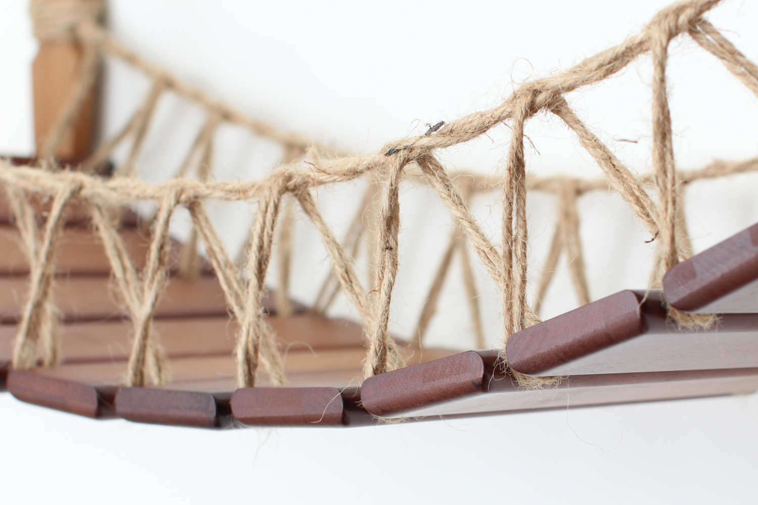 This photo displays a close up of the Cat Bridge in English Chestnut, a dark brown stain.