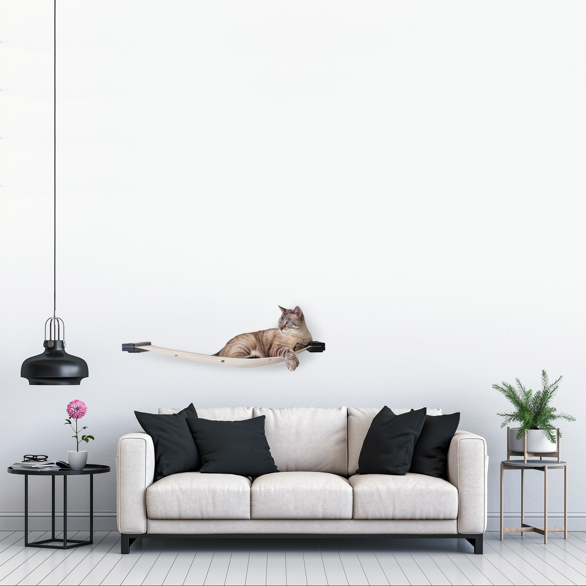 This photo displays our cat relaxing on the 32-Inch Cat Lounge in a living room setting. This image shows the Lounge in Onyx, a black stain, and has Natural fabric, a light tan color.