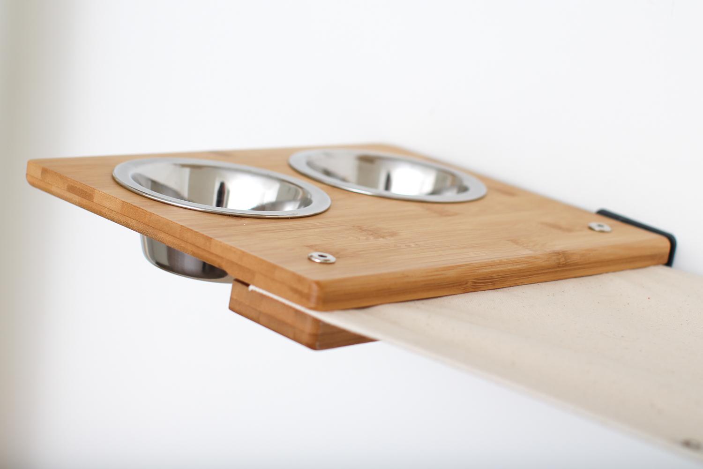 close up of wall mounted feeder bowl shelf