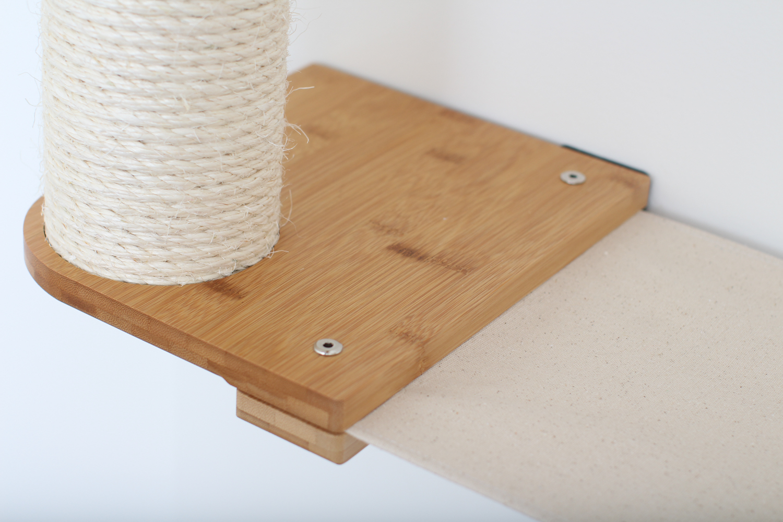 close up of wall mounted scratching post platform