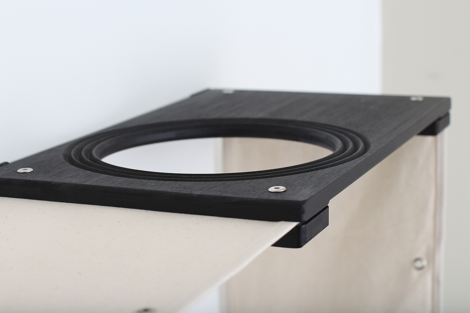 This photo displays a close up of the Escape Hatch that is included with the Deluxe Cat Maze.