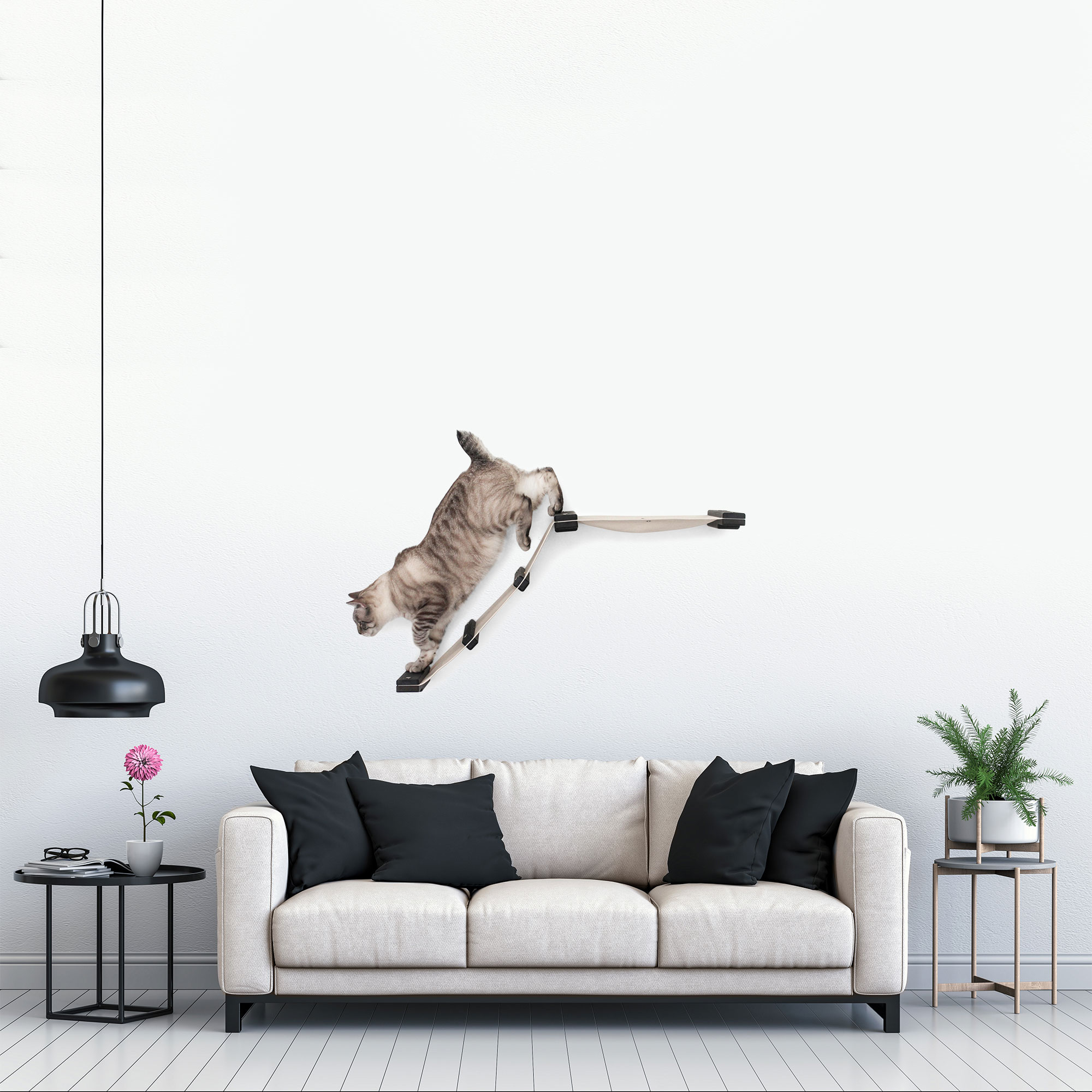 This photo displays our cat walking on the ladder of the Lift mounted in a living room setting. This image shows the Lift in Onyx, a black stain, with Natural fabric, a light tan color.