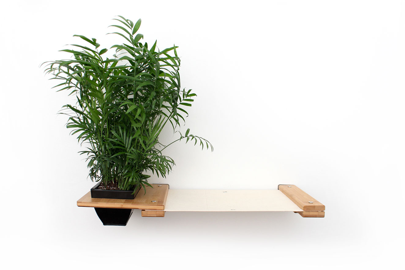 This photo displays the Planter Lounge in Natural, a light brown stain, with Natural fabric, a light tan color.