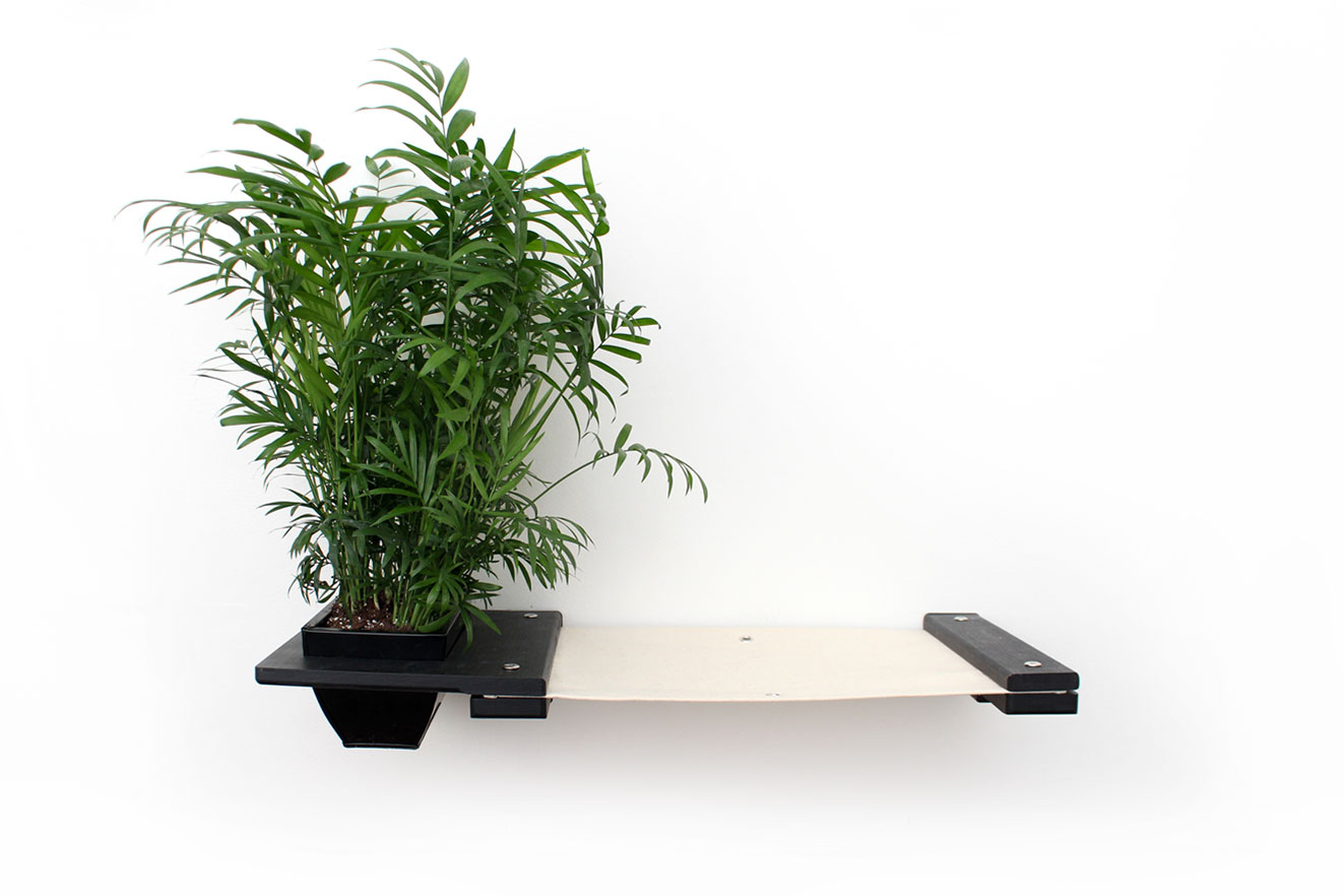 This photo displays the Planter Lounge in Onyx, a black stain, with Natural fabric, a light tan color.