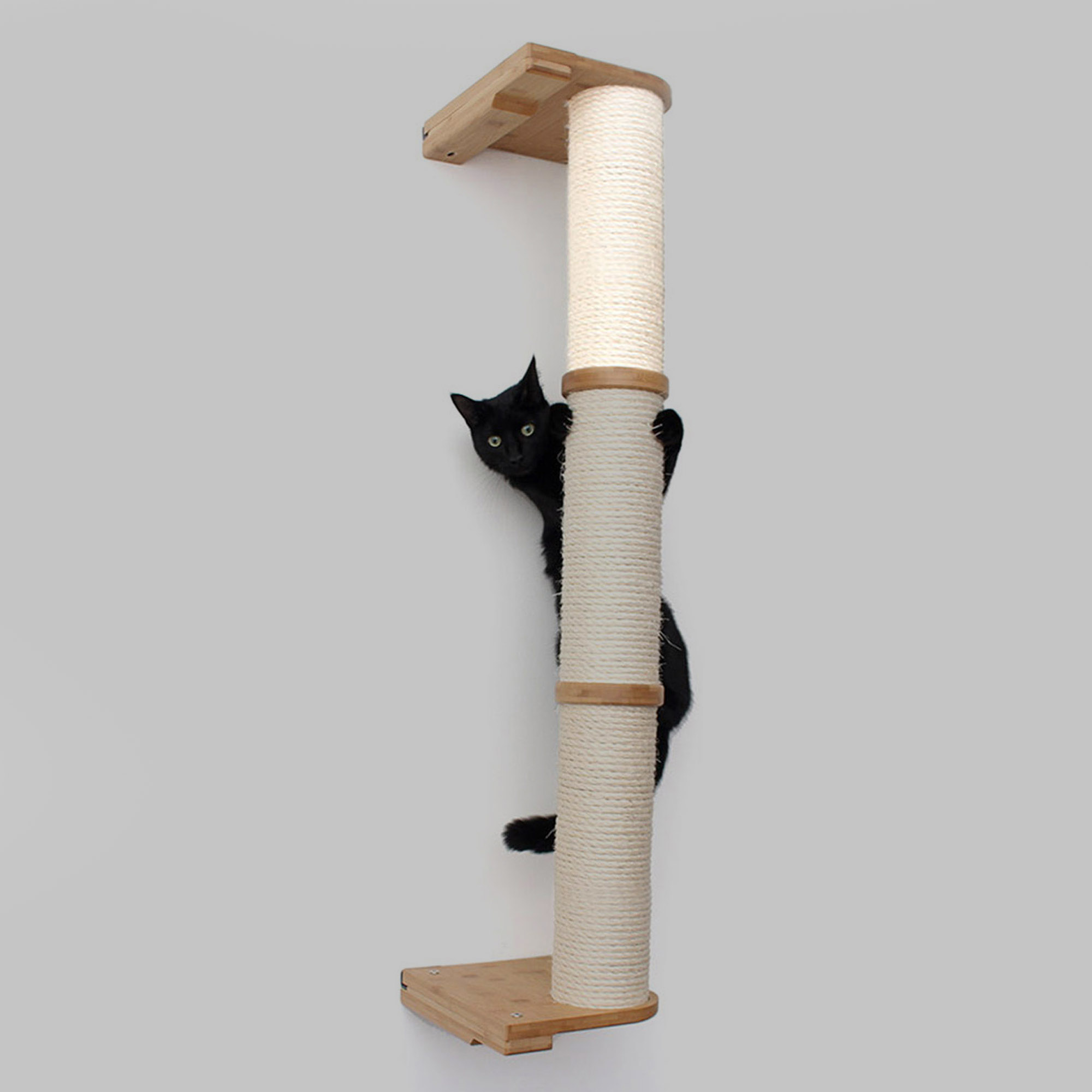 This image displays a cat climbing the three tier Sisal Pole, with one Sisal Pole segment highlighted. The Sisal Pole segment can be used to replace an old one, or to add height to your current Sisal Pole.