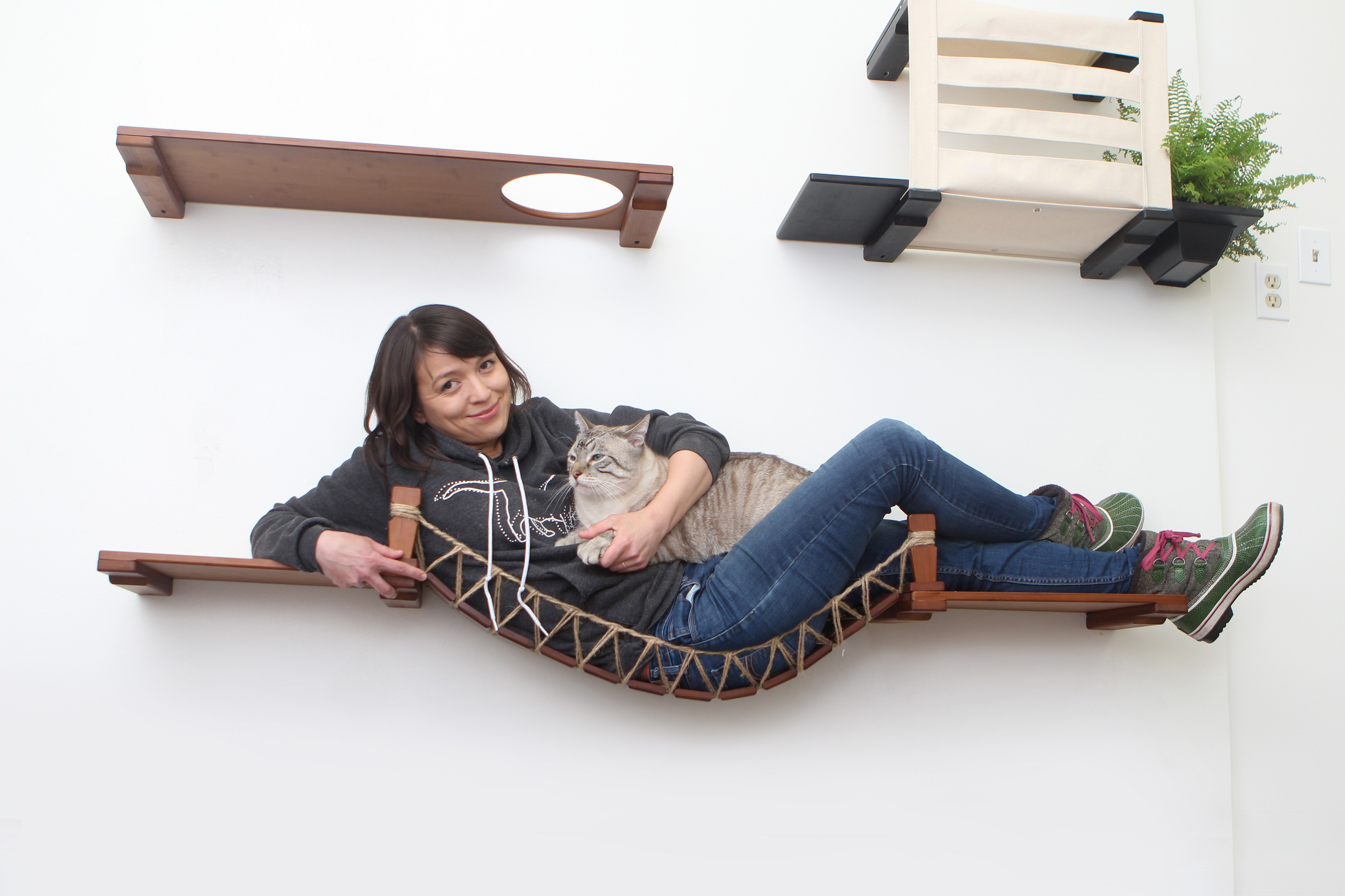 This photo displays Megan and one of our cats lounging on the Bridge with Landings as a weight test for our furniture.