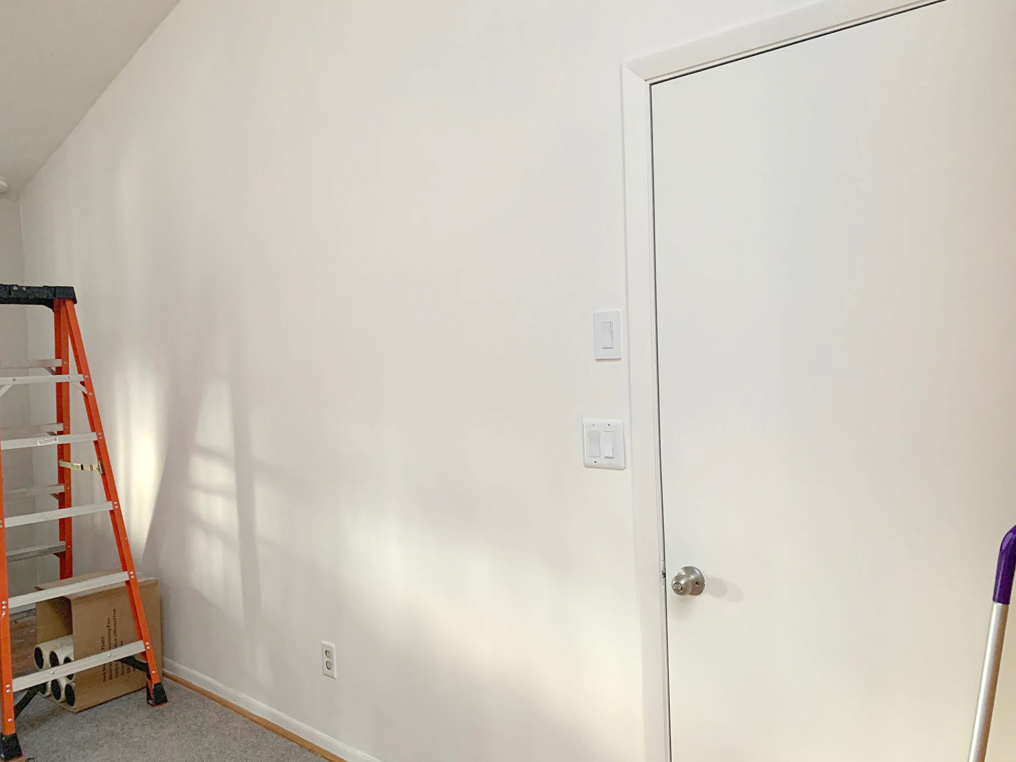 blank wall with ladder