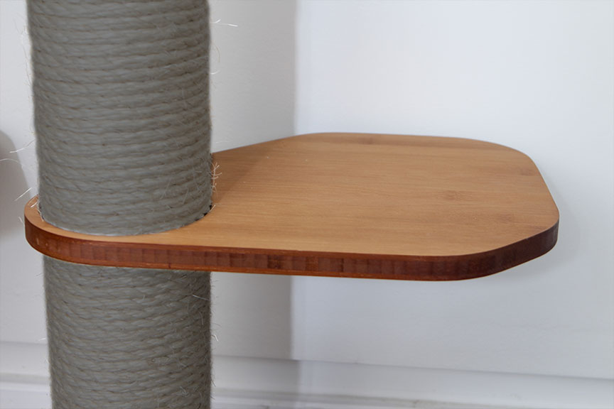 This photo displays our Leaf Connector in English Chestnut, a dark brown stain finish. The Leaf Connector is an additional piece for the Sisal Pole in order to provide more space for cats to move around.