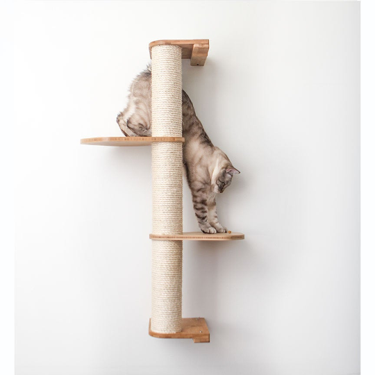 This image displays our cat climbing down the Leaf Connectors of a three tier Deluxe Sisal Climbing Pole. The Sisal Pole and Leaf Connectors are in Natural, a light brown stain.