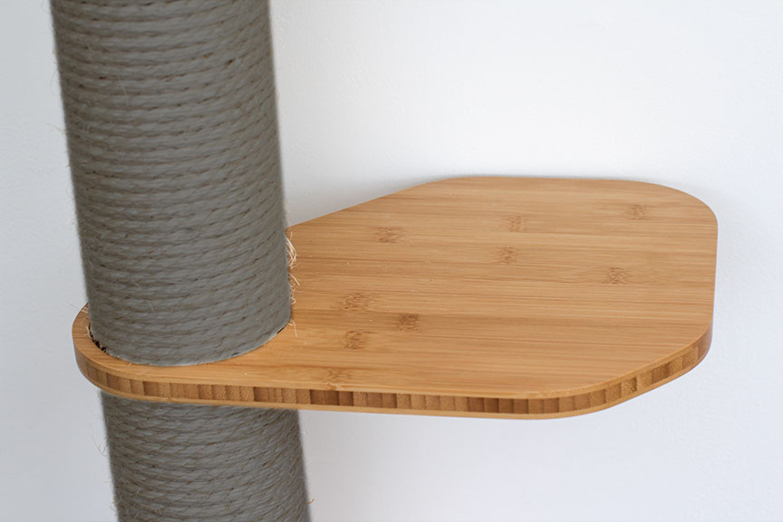 This photo displays our Leaf Connector in Natural, a light brown stain finish. The Leaf Connector is an additional piece for the Sisal Pole in order to provide more space for cats to move around.