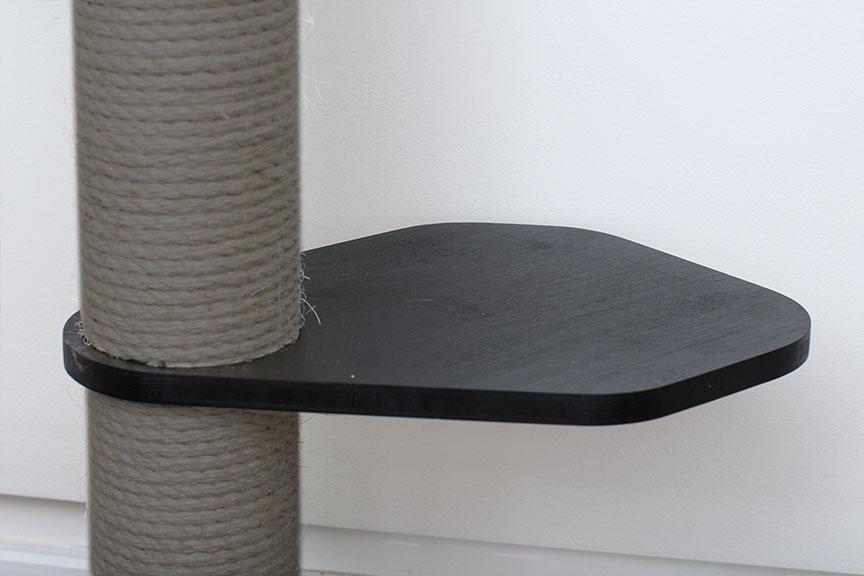 This photo displays our Leaf Connector in Onyx, a black stain finish. The Leaf Connector is an additional piece for the Sisal Pole in order to provide more space for cats to move around.