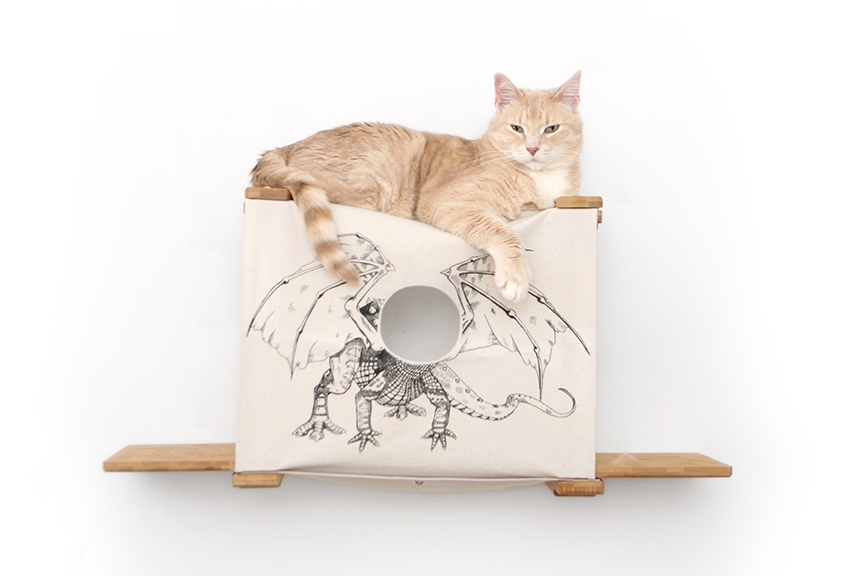 Wall mounted cat tunnel cubby with ledges with light orange cat relaxing on top