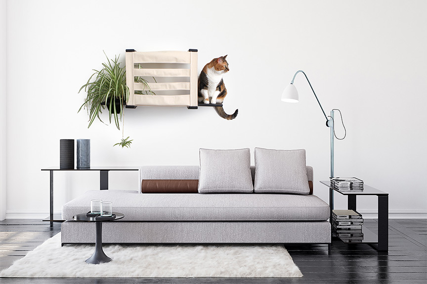 Wall mounted cat tunnel cubby with ledges shown in room